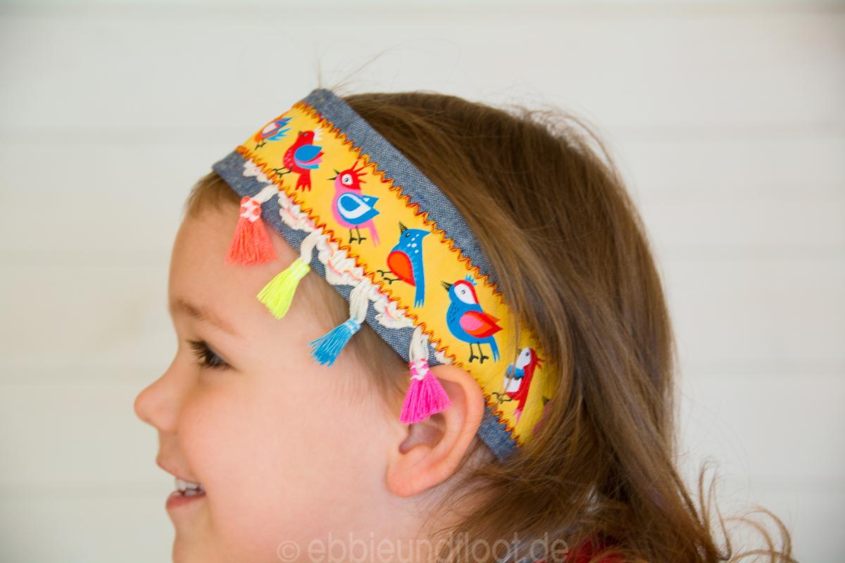 Süßes breites Haar- oder auch Stirnband mit Quasten