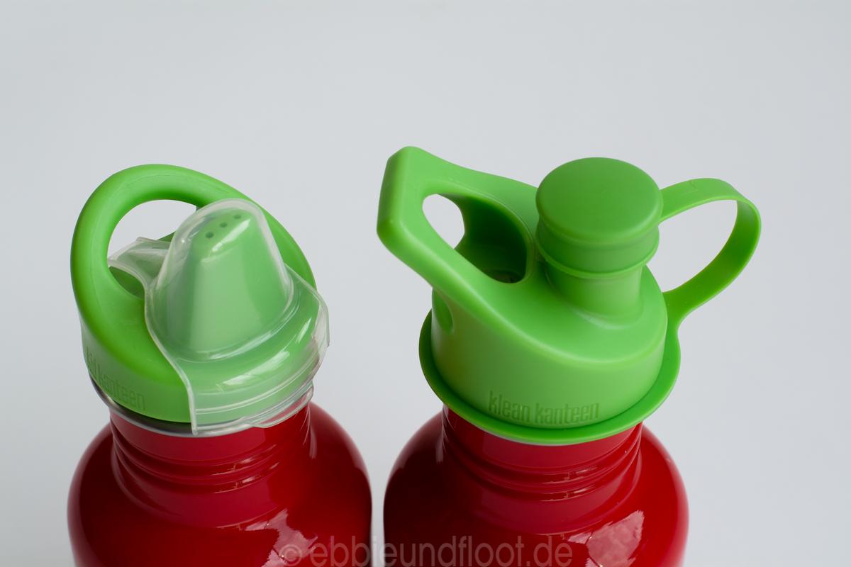 Zwei unterschiedliche Flaschensystem mit Staubschutzkappen